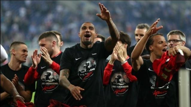 Frankfurt's Kevin-Prince Boateng (C) celebrates after winning the German DFB Cup semi final soccer match between FC Schalke 04 and Eintracht Frankfurt. EPA/FRIEDEMANN VOGEL