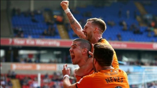 Wolverhampton Wanderers' Conor Coady celebrates scoring his side's fourth goal of the game with Barry Douglas (top) and Ruben Neves during the Sky Bet Championship match at the Macron Stadium, Bolton.