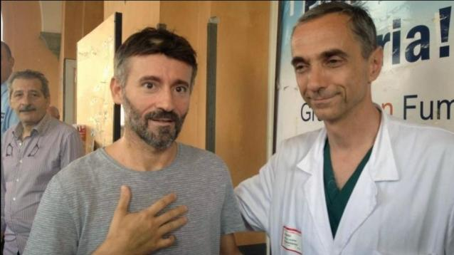 Motorcyclist Max Biaggi (l) leaves the San Camillo Roman hospital