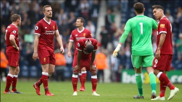 Liverpool's Jordan Henderson (second left) and team-mates appear dejected after the Premier League match at The Hawthorns, West Bromwich.