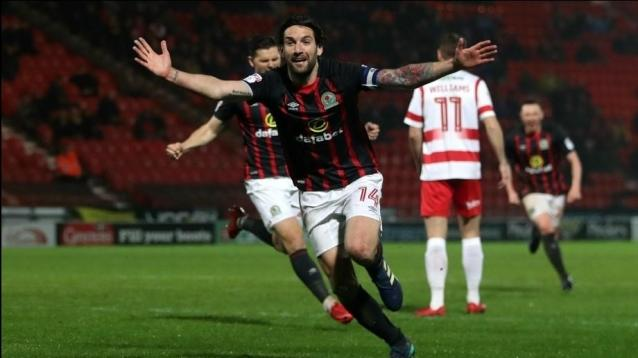 Blackburn Rovers' Charlie Mulgrew celebrates scoring his side's first goal of the game during the Sky Bet League One match at the Keepmoat Stadium, Doncaster.