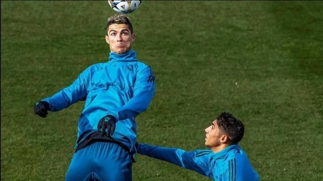 Real Madrid's Portuguese striker Cristiano Ronaldo (L) and Moroccan defender Achraf Hakimi (R)