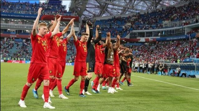 Players of Belgium greet supporters